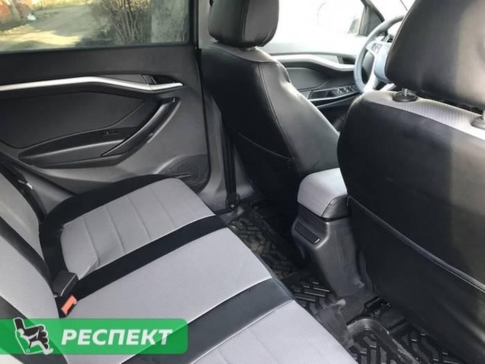 Черно-серые авточехлы из экокожи на Lada Vesta 2018г. с дизайном 'обычный' без декоративных строчек производства Респект