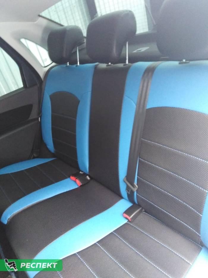 Черно-синие авточехлы из экокожи на Lada Granta FL 2019г. с дизайном 'обычный' без декоративных строчек производства Респект