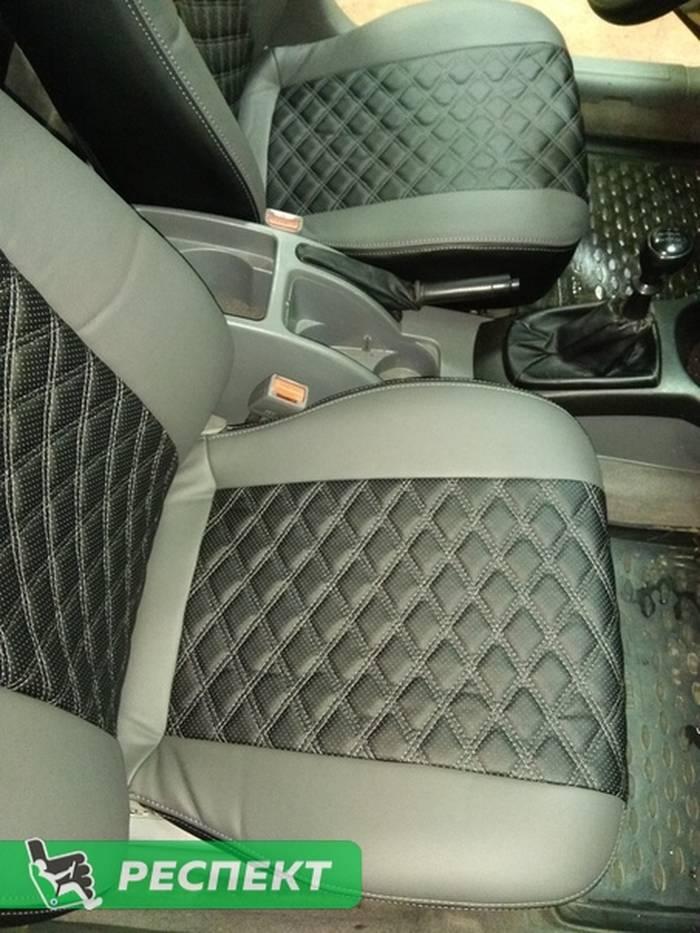 Черно-серые авточехлы из экокожи на Chevrolet Lacetti 2009г. с дизайном 'двойные ромбы' и двойной декоративной строчкой серыми нитками производства Респект
