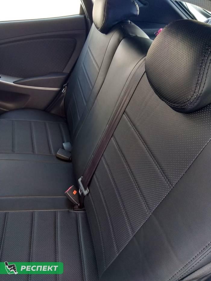 Черные авточехлы из экокожи на Hyundai Solaris 2012г. с дизайном 'двойные горизонтальные полосы' и двойной декоративной строчкой черными нитками производства Респект