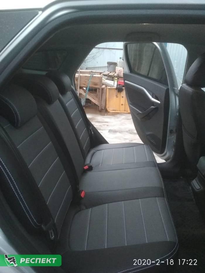 Черно-серые авточехлы из экокожи на Lada Vesta 2018г. с дизайном 'обычный' и двойной декоративной строчкой производства Респект