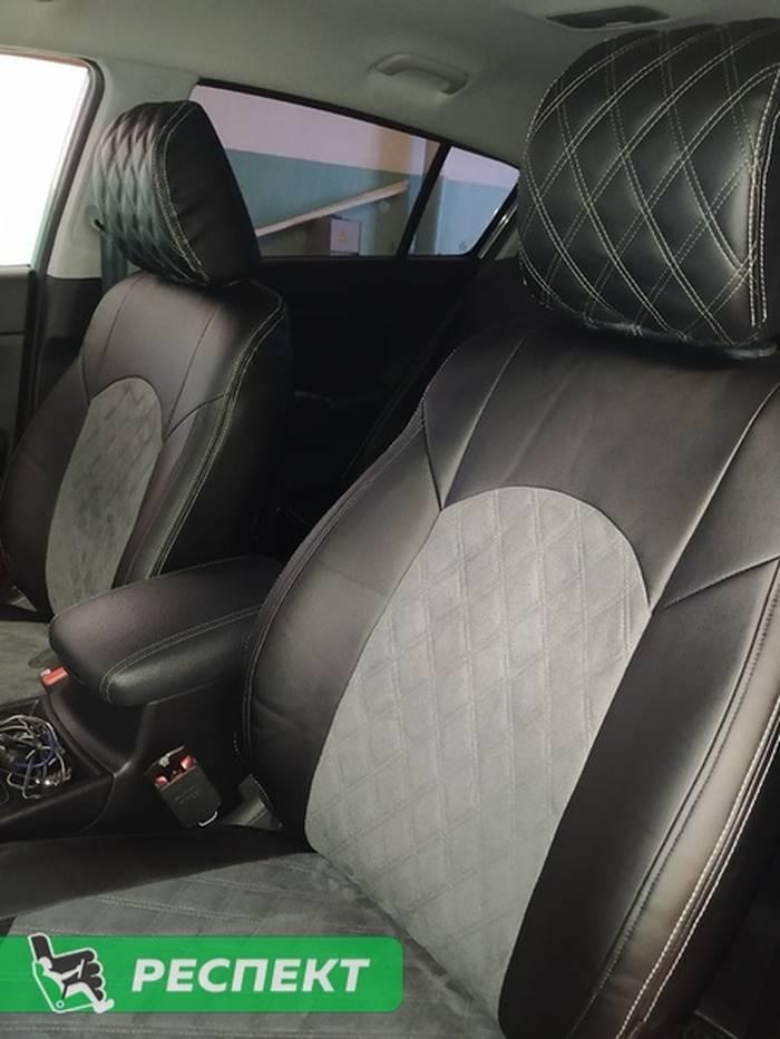Черно-серые авточехлы из экокожи на Kia Sportage 2019г. с дизайном 'двойные ромбы' и двойной декоративной строчкой производства Респект