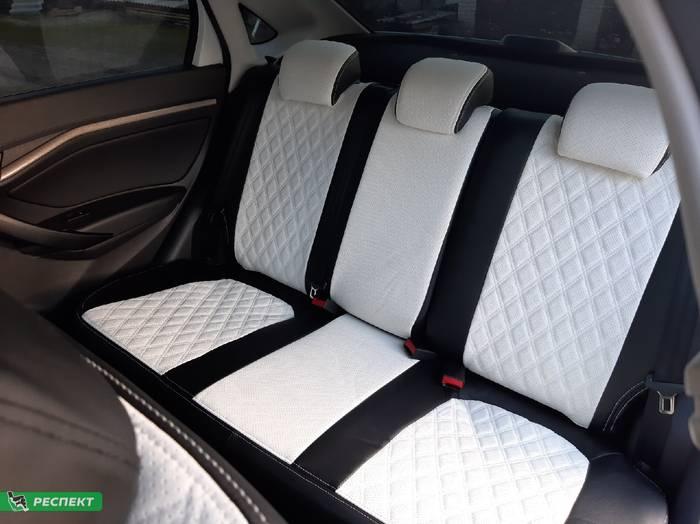 Черно-белые авточехлы из экокожи на Lada Vesta 2017г. с дизайном 'двойные ромбы' и двойной декоративной строчкой производства Респект