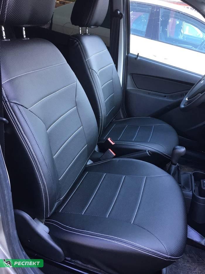 Черные авточехлы из экокожи на Lada Granta FL 2020г. с дизайном 'обычный' и двойной декоративной строчкой белыми нитками производства Респект