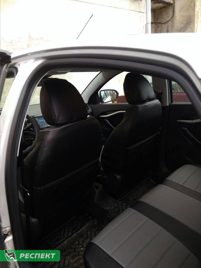 Черно-серые авточехлы из экокожи на Lada Vesta 2016г. с дизайном 'обычный' без декоративных строчек производства Респект