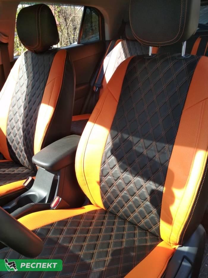Черно-оранжевые авточехлы из экокожи на Hyundai Creta 2018г. с дизайном 'двойные ромбы' и двойной декоративной строчкой оранжевыми нитками производства Респект