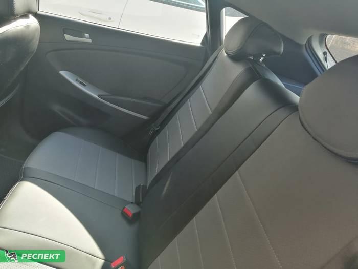 Черно-серые авточехлы из экокожи на Hyundai Solaris 2014г. с дизайном 'обычный' и двойной декоративной строчкой производства Респект