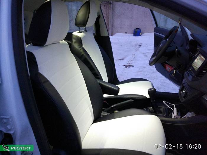 Черно-белые авточехлы из экокожи на Lada Vesta 2018г. с дизайном 'обычный' без декоративных строчек производства Респект