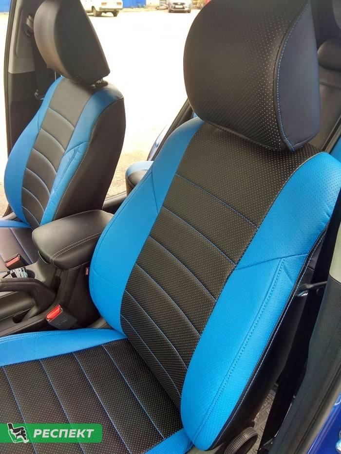 Черно-синие авточехлы из экокожи на Kia Sportage 2018г. с дизайном 'обычный' и одинарной декоративной строчкой синими нитками производства Респект