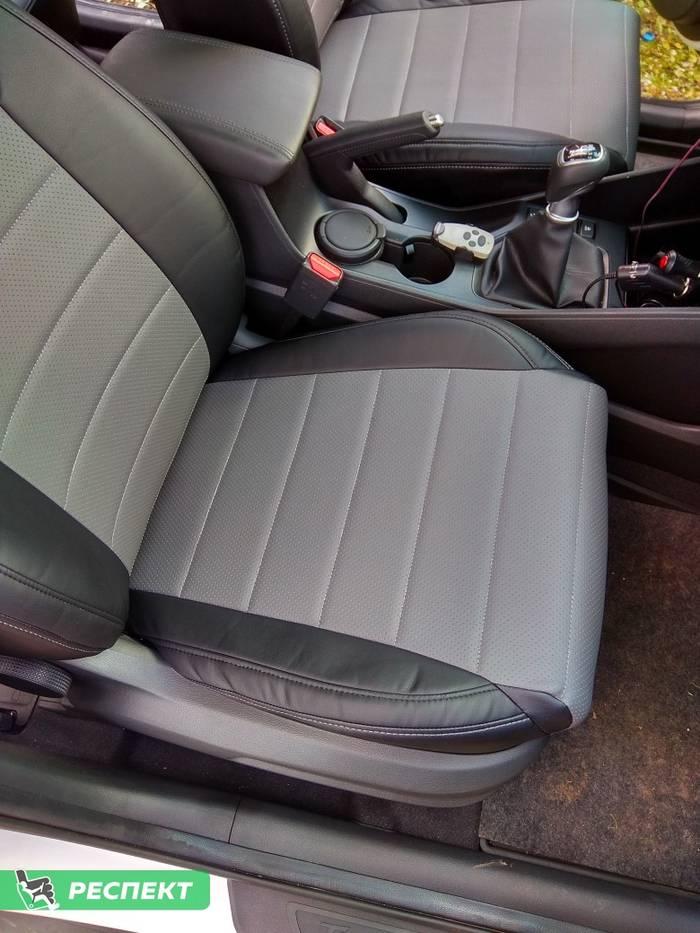 Черно-серые авточехлы из экокожи на Hyundai Tucson 2017г. с дизайном 'обычный' и одинарной декоративной строчкой серыми нитками производства Респект